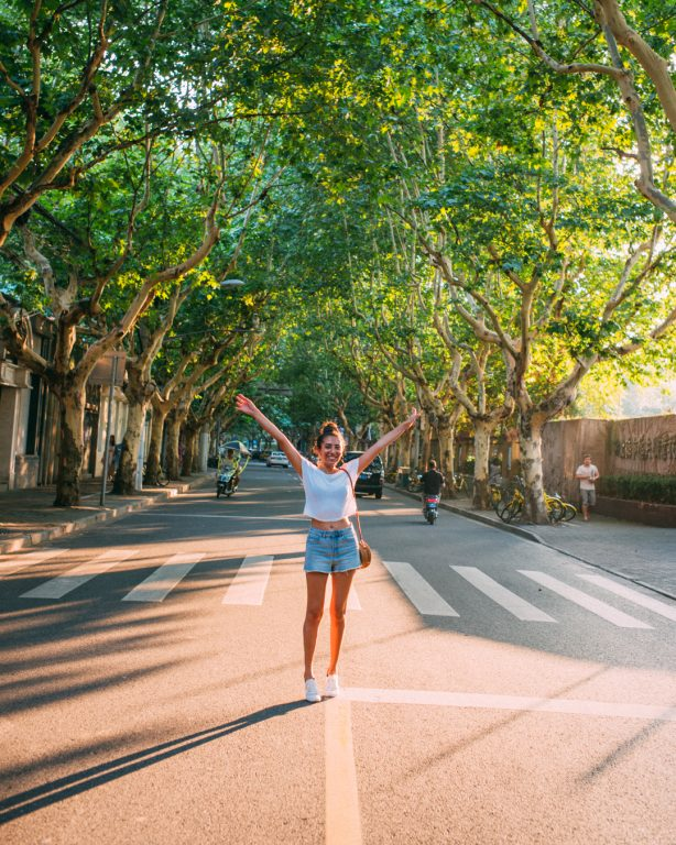 French concession street trees women open arms