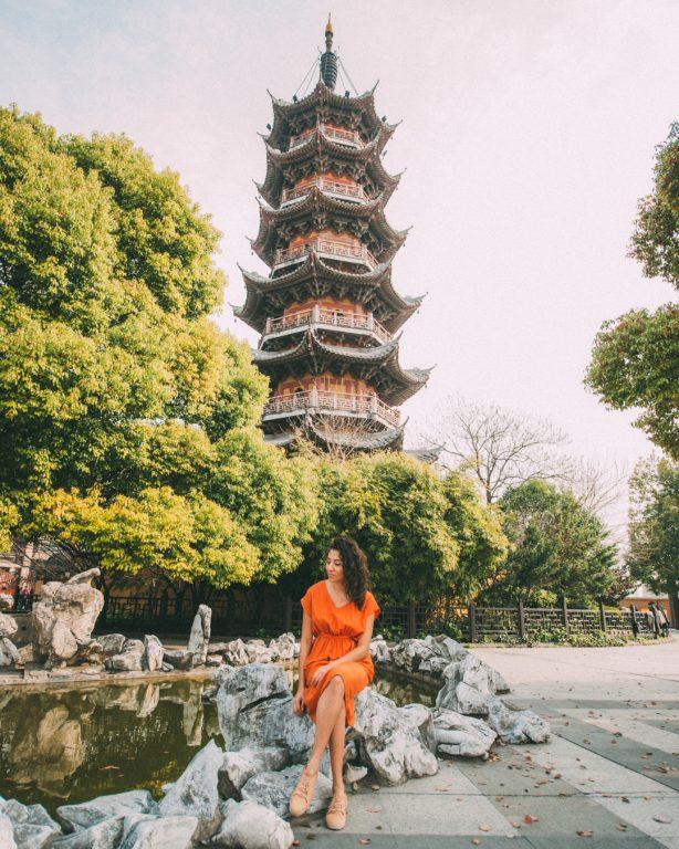 Longhua temple pagoda Shanghai women in orange dress