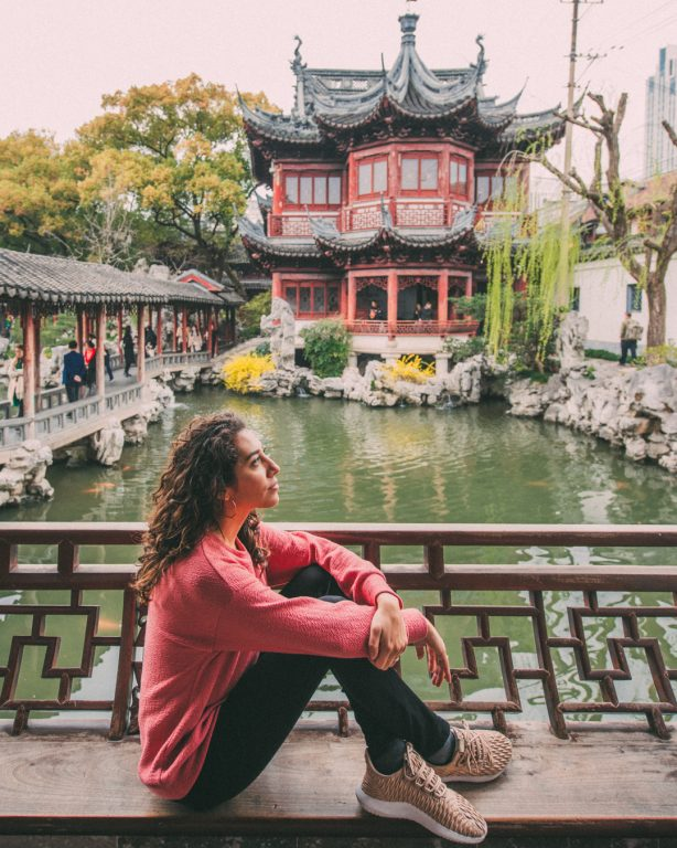 Yu garden architecture chinese women with pink sweater