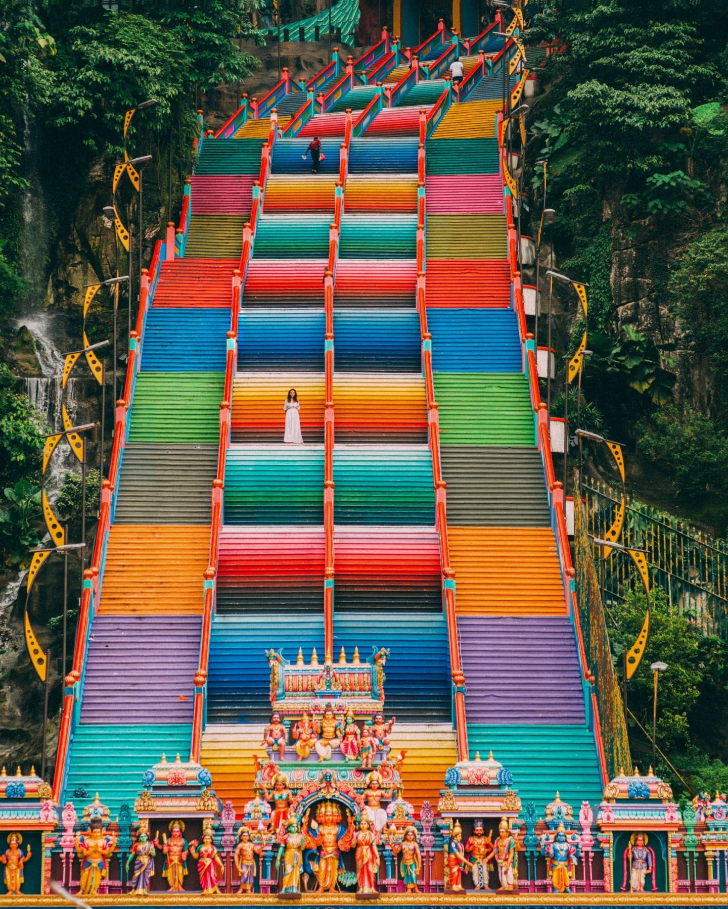 women at the rainbow stairs in the Batu caves