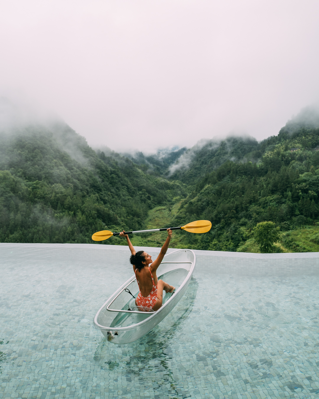 women in kayak at the pool at zhangjiajie