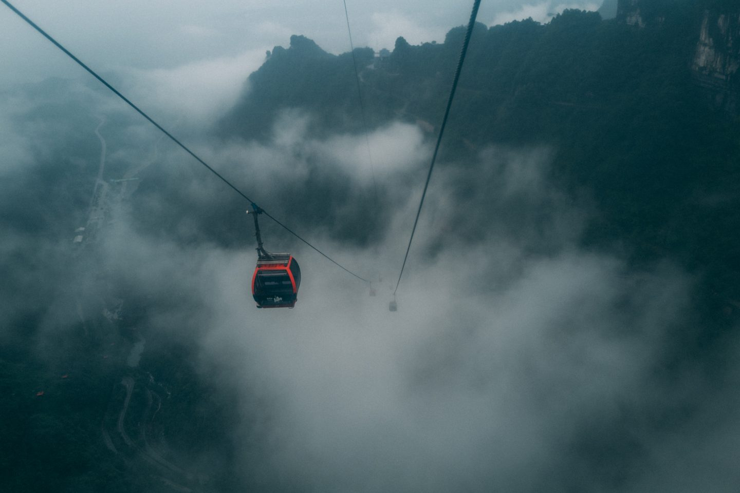 photo from the mountains in the cable car observing another cable car approaching