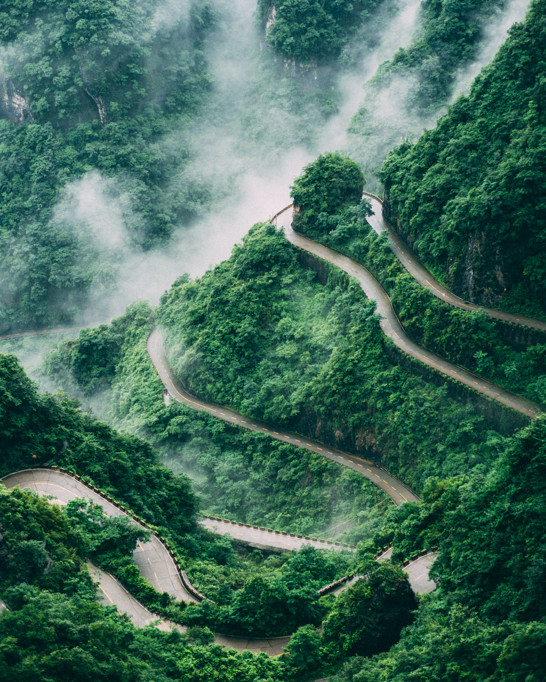 foggy mountains and a dangerous road to go up